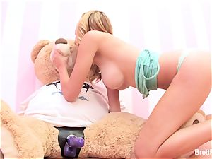 Brett Rossi plays with a inserted bear's strap-on fuck stick