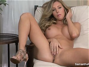 big-chested ash-blonde Samantha Saint thumbs her vag