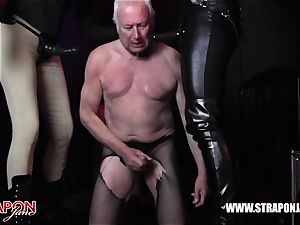 Femdoms latex dominate tag team sissy face tear up strap-on