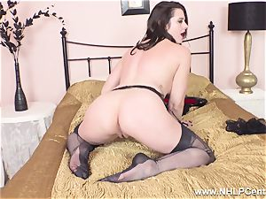 uber-sexy cougar masturbates to climax in sheer nylons garters
