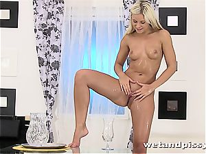 Darling Dido Angel in the douche letting her splooge blast
