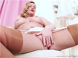 mischievous blonde cougar thumbs saucy slit in nylons heels