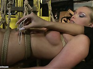 Kathia Nobili and Mandy Bright assets binding with strap